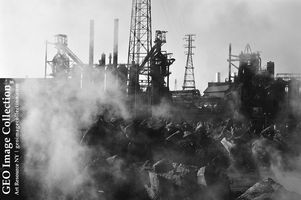 Hot slag waste from steelmaking at the Edgar Thompson USX steel metal mill cools outside the factory.
