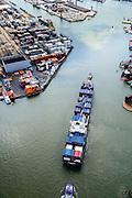 Nederland, Zuid-Holland, Rotterdam, 10-06-2015; Container schip CMA CGM Azure vaart de Eemhaven binnen, geassisteerd door twee sleepnoten van Fairplay, <br /> Container ship entering Eem harbour being assisted by tugs.<br /> luchtfoto (toeslag op standard tarieven);<br /> aerial photo (additional fee required);<br /> copyright foto/photo Siebe Swart