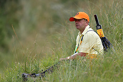 A marshal looks on from the rough during practice day four of The Open Championship 2017 at Royal Birkdale Golf Club, Southport.