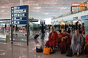 Buddhist monks in Terminal Three of Beijing Capital International Airport, China