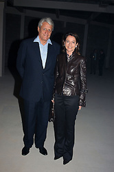 DR & MRS GERT RUDOLPH FLICK he is the German multi-millionaire at an exhibition of work by Rolf Sachs - a unique world-renowned contemporary furniture designer, held in association with the Louisa Guinness Gallery and held at 250 Brompron Road, London on 6th October 2004.<br />