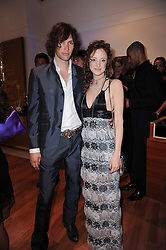 ANDREA RISEBOROUGH and JOE APPEL at a party to celebrate the B.zero 1 design by Anish Kapoor held at Bulgari, 168 New Bond Street, London n 2nd June 2010.
