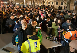 © Licensed to London News Pictures. 31/12/2018. London, UK. Bottles and cans are removed as crowds go through a security check on The Mall as they arrive to celebrate New Year's Eve in central London.  Over 100,000 people are attending London's ticketed fireworks display on the banks of the River Thames for New Year's Eve tonight. Photo credit: Peter Macdiarmid/LNP