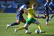 Wycombe Wanderers midfielder Garath McCleary (19) battles for possession  with Norwich City midfielder (on loan from Tottenham Hotspur) Oliver Skipp (20) during the EFL Sky Bet Championship match between Wycombe Wanderers and Norwich City at Adams Park, High Wycombe, England on 28 February 2021.