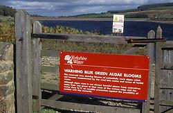 Sign warning of blue & green algal blooms; Leighton Reservoir; Yorkshire Water; Nr Masham; UK