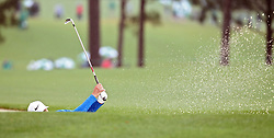 April 7, 2018 - Augusta, GA, USA - Kyle Stanley hits out of a fairway bunker on the 1st hole during the third round of the Masters Tournament on Saturday, April 7, 2018, at Augusta National Golf Club in Augusta, Ga. (Credit Image: © Jason Getz/TNS via ZUMA Wire)