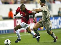 Photo Aidan Ellis.<br />Manchester United v Barcelona (at the Lincoln Financial Field Philadelphia) 03/08/03.<br />United's David Bellion beats Barcelona's Patrick Anderson