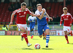 Peterborough United's Connor Washington in action with Swindon Town's Jack Stephens - Photo mandatory by-line: Joe Dent/JMP - Mobile: 07966 386802 - 11/04/2015 - SPORT - Football - Swindon - County Ground - Swindon Town v Peterborough United - Sky Bet League One