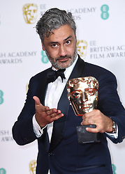 Taika Waititi with the award for Best Adapted Screenplay at the 73rd British Academy Film Awards held at the Royal Albert Hall, London.. Photo credit should read: Doug Peters/EMPICS