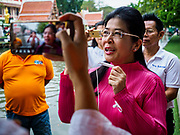 05 JANUARY 2019 - MINBURI, BANGKOK, THAILAND: SUDARAT KEYURAPHAN (pink blouse), the Pheu Thai Party candidate for Prime Minister of Thailand, tours the floating market during voter outreach at the Kwan Riam Floating Market at Wat Bamphen Nuea in Minburi, east of downtown Bangkok. The Thai government has tentatively scheduled a general election for 24 February 2019. It will be Thailand's first election since a military coup overthrew the government of Yingluck Shinawatra in 2014. Yingluck was a the leader of the Pheu Thai Party before her ouster. Sudarat was a member of Thaksin Shinawatra's cabinet. Thaksin's government was also deposed by a coup in 2006.      PHOTO BY JACK KURTZ