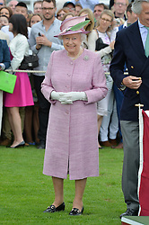HM The QUEEN at the Cartier Queen's Cup Polo final at Guard's Polo Club, Smiths Lawn, Windsor Great Park, Egham, Surrey on 14th June 2015