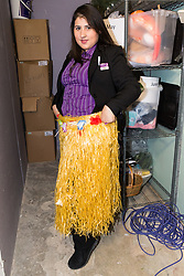 Assistant Manager Bruna Salvadori poses with what appears to be a Hawaiian skirt in the Premier Inn Smithfield lost property room. London, July 24 2019.