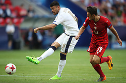 Italy's Andrea Petagna (left) hits a shot on goal whilst under pressure from Czech Republic's Milan Havel