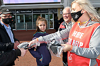 Football - 2020 / 2021 Sky Bet Championship - Play-offs - Semi-final, second leg - Swansea City vs Barnsley - Liberty Stadium.<br /> <br /> fans receive masks as they arrive for the sit game with fans at swansea since the start of Coronavirus Act 2020<br /> <br /> COLORSPORT/WINSTON BYNORTH