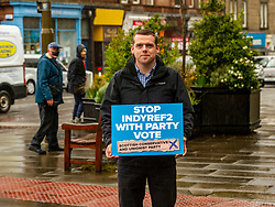 Pictured: <br />Douglas Ross was in the Morningside area of Edinburgh today to ask for the peach party vote to be made in favour of the Scottish Conservatives. Mr Rosss was joined by candidates Rebecca Fraser, Miles Briggs, Jeremy Balfour, Marie-Clair Munro and her dog Kai<br />Ger Harley   EEm 27 April 2021