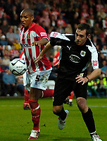 Photo: Ed Godden.<br /> Cheltenham Town v Bristol City. Carling Cup. 22/08/2006.<br /> Gavin Caines (L) chases the ball for Cheltenham.