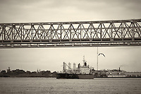 Dusita Narre under Mississippi River Bridge in New Orleans, Louisiana. Image taken with a Nikon D300 and 18-200 mm lens (ISO 200, 95 mm, f/5.6, 1/1250 sec). Processed with Capture One Pro (including conversion to B&W).