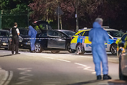 © Licensed to London News Pictures. 31/05/2021. London, UK. Forensic investigators at the crime scene at Montrose Park, Edgware following the fatal stabbing of an 18-year-old male. Metropolitan Police were called at 17:54 BST on Monday 31/05/2021 following reports of a group of males fighting. The man was found suffering from a stab injury in a tennis court area. He was treated by London's Air Ambulance and London Ambulance Service at the scene but was pronounced dead at 19:19 BST. Photo credit: Peter Manning/LNP