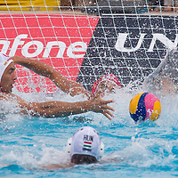 Tamas Varga (back) of Hungary fights with Matteo Aicardi (front) of Italy during the Vodafone Waterpolo Cup in Budapest, Hungary on July 16, 2012. ATTILA VOLGYI