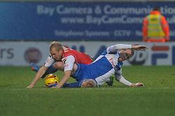 Bristol Rovers' David Clarkson tackles Morecambe's Robbie Threlfall - Photo mandatory by-line: Dougie Allward/JMP - Tel: Mobile: 07966 386802 14/12/2013 - SPORT - Football - Morecombe - Globe Arena - Morecombe v Bristol Rovers - Sky Bet League Two