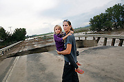 """LONGMONT, CO - SEPTEMBER 13: Samantha Kinzig, of Longmont, Colorado, and her five year-old daughter Isabel take in closer view of a damaged bridge on Weld County Road 1 in Longmont, Colorado as heavy rains for the better part of week fueled widespread flooding in numerous Colorado towns on September 13, 2013. Kinzig is a Colorado native and said she's never seen anything like this adding, """"this is amazing to me"""". (Photo by Marc Piscotty/ © 2013)"""
