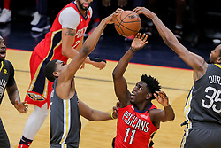 May 6, 2018 - New Orleans, LA, U.S. - NEW ORLEANS, LA - MAY 06:  New Orleans Pelicans guard Jrue Holiday (11) has a shot blocked by Golden State Warriors forward Kevin Durant (35) and forward Kevon Looney (5) during game 4 of the NBA Western Conference Semifinals at Smoothie King Center in New Orleans, LA on May 06, 2018.  (Photo by Stephen Lew/Icon Sportswire) (Credit Image: © Stephen Lew/Icon SMI via ZUMA Press)