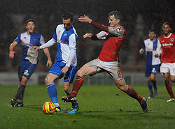 Bristol Rovers' Chris Beardsley is challenged by Morecambe's Tony Diagne - Photo mandatory by-line: Dougie Allward/JMP - Tel: Mobile: 07966 386802 14/12/2013 - SPORT - Football - Morecombe - Globe Arena - Morecombe v Bristol Rovers - Sky Bet League Two