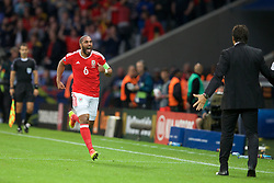 5LILLE, FRANCE - Friday, July 1, 2016: Wales' captain Ashley Williams celebrates scoring his sides first goal to make the score 1-1 during the UEFA Euro 2016 Championship Quarter-Final match  against Belgium at the Stade Pierre Mauroy. (Pic by Paul Greenwood/Propaganda)
