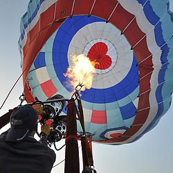 ©London News pictures. 07/04/2011. CANTERBURY: The Royal Airforce balloon is prepared for flight. Approximately 50 hot air balloons from across the UK and Europe take advantage of the weather window and take off from Lydden Hill Race Circuit, Wootton, Kent, to fly across the English Channel marking the largest ever group of balloons to attempt the crossing. The participants  have been waiting since October for the event to happen. Picture credit should read Stephen Simpson/LNP