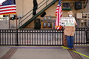 """16 OCTOBER 2020 - PERRY, IOWA: A woman waits for Doug Emhoff, the husband of Vice Presidential Candidate Kamala Harris, to speak at a """"Get Out the Event."""" Emhoff spoke to a group of about 30 people. The crowd was socially distanced and masks were required in  keeping with CDC and state of Iowa health guidelines to deal with the COVID-19 pandemic. Emhoff is traveling throughout Nebraska and Iowa today, campaigning on behalf of the Biden/Harris ticket.         PHOTO BY JACK KURTZ"""