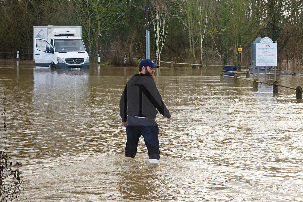 ©Licensed to London News Pictures 21/12/2019. <br /> Yalding ,UK. The driver walking to his broken down van in flood water 3ft high in parts on the Lees Road, Yalding.  The River Medway in Yalding, Kent has bursts its banks causing severe flooding to the village.   Photo credit: Grant Falvey/LNP