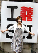 Liu Yi poses by a 'I love Shanghai' sign, in busy shopping neighborhood Taikang lu, in Shanghai, China, on September 15, 2009. Photo by Lucas Schifres/Pictobank