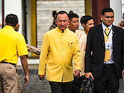 09 JUNE 2016 - BANGKOK, THAILAND: Thais leave Wat Phra Kaew on the grounds of the Grand Palace before a special merit making ceremony Thursday. Thailand marked 70 years of the reign of Bhumibol Adulyadej, the King of Thailand, with a special alms giving ceremony for 770 monks in front of the Grand Palace in Bangkok. The King, also known as Rama IX, ascended the throne on 9 June 1946. He is the longest serving monarch in Thai history and the longest serving monarch in the world today. He is revered by most Thais and is widely seen as a unifying figure in the country.      PHOTO BY JACK KURTZ