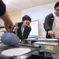 Jasilyn Kinsel, left, and Jayden Kinsel dry their recycled paper on hot plates in the final stage of creating paper in a demonstration by Bio Papel at Kennedy Middle School in Gallup Wednesday.