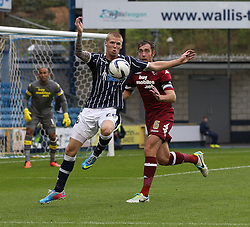 Millwall's Andrew Keogh controls the ball under pressure from Derby County's Richard Keogh  - Photo mandatory by-line: Robin White/JMP - Tel: Mobile: 07966 386802 14/09/2013 - SPORT - FOOTBALL -  The Den - London - Millwall V Derby County - Sky Bet League Championship