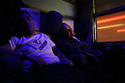 """EXP 823 Freccia del sud. People sleep during the long journey (24 hours) from Agrigento (Sicily) to Milan (Lombardia) Because of the severe economic crisis that is crossing the Italy south, many workers, including many fathers, are forced to emigrate to the north Italy to look for jobs at the factory.<br /> The wife and children remain in the south Italy, and every friday night depart trains from the north to south are full of men that come back at home for the weekend.<br /> The only trains that are cheap are the night trains.<br /> The train """"exp 823 Freccia del Sud"""" was one of them.<br /> It is the train journey with the longest working in Italy, it covers nearly 1600 km separating Milan (Lombardy, north Italy) from Agrigento (Sicily- south Italy) in approximately 24 hours.<br /> The internal migration in Italy is for the ruling class a normal social life in Italy.<br /> To these workers, in the country's total indifference, Italy owes much."""