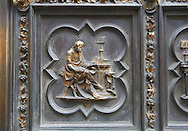 Scenes from the early Renaissance south door of the Baptistry of Florence ( Battistero di San Giovanni ) made by Andrea Pisano in 1329 showing scenes from the life of John The Baptist , made in bronze and guilded in gold. The Bapistry of the Duomo, Florence Italy .<br /> <br /> If you prefer you can also buy from our ALAMY PHOTO LIBRARY  Collection visit : https://www.alamy.com/portfolio/paul-williams-funkystock/romanesque-art-antiquities.html . Type -   Florence Baptistry  - into the LOWER SEARCH WITHIN GALLERY box. Refine search by adding background colour, place, museum etc<br /> <br />  Visit our MEDIEVAL ROMANESQUE PHOTO COLLECTIONS for more   photos  to download or buy as prints https://funkystock.photoshelter.com/gallery-collection/Medieval-Romanesque-Art-Antiquities-Historic-Sites-Pictures-Images-of/C0000uYGQT94tY_Y .<br /> <br /> Visit our ITALY PHOTO COLLECTION for more   photos of Italy to download or buy as prints https://funkystock.photoshelter.com/gallery-collection/2b-Pictures-Images-of-Italy-Photos-of-Italian-Historic-Landmark-Sites/C0000qxA2zGFjd_k<br /> .<br /> <br /> Visit our MEDIEVAL PHOTO COLLECTIONS for more   photos  to download or buy as prints https://funkystock.photoshelter.com/gallery-collection/Medieval-Middle-Ages-Historic-Places-Arcaeological-Sites-Pictures-Images-of/C0000B5ZA54_WD0s