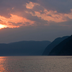 A scene from the water in the Saguenay Fjord.  Parc du Saguenay, Quebec, Canada.