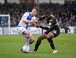 Ollie Clarke of Bristol Rovers is challenged by Neil Danns of Bury - Mandatory by-line: Neil Brookman/JMP - 30/03/2018 - FOOTBALL - Memorial Stadium - Bristol, England - Bristol Rovers v Bury - Sky Bet League One