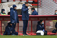 Stevenage manager Alex Revell  pointing, directing, signalling, gesture in the technical area during the EFL Sky Bet League 2 match between Stevenage and Carlisle United at the Lamex Stadium, Stevenage, England on 20 March 2021.