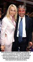 MISS HEATHER BIRD and ROBERT TCHENGUIZ, at a party in London on 18th May 2004.PUG 386