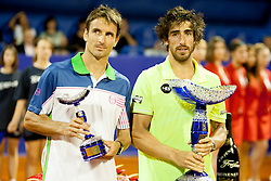 Tommy Robredo of Espana and Pablo Cuevas of Uruguay during flower ceremony after final of singles at 25th Vegeta Croatia Open Umag, on July 27, 2014, in Stella Maris, Umag, Croatia. Photo by Urban Urbanc / Sportida