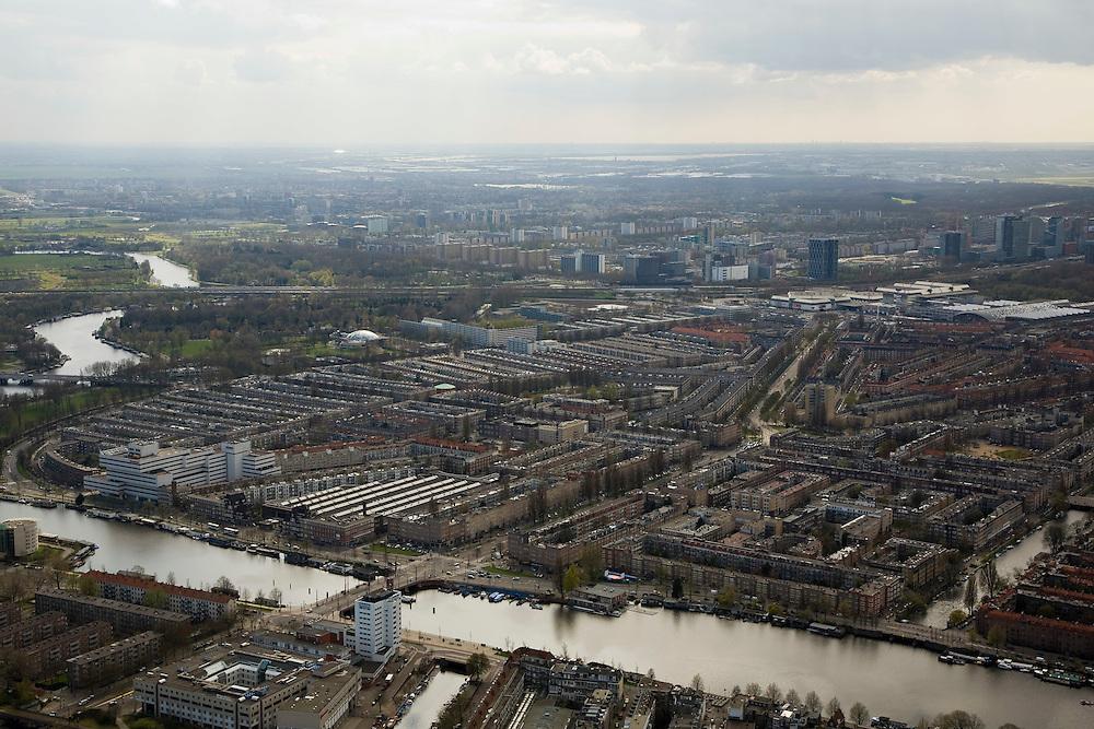 Nederland, Amsterdam, Amstel, 16-04-2008;  zicht op de Rivierenbuurt; Berlagebrug van Weesperzijde naar de Amsteldijk, in het verlengde van de brug de Vrijheidslaan (met Wolkenkrabber); op het middenplan (rechts) de hoogbouw rond de RAI (het witte complex) en de Zuid-as; in de verre verte Buitenveldert..luchtfoto (toeslag); aerial photo (additional fee required); .foto Siebe Swart / photo Siebe Swart