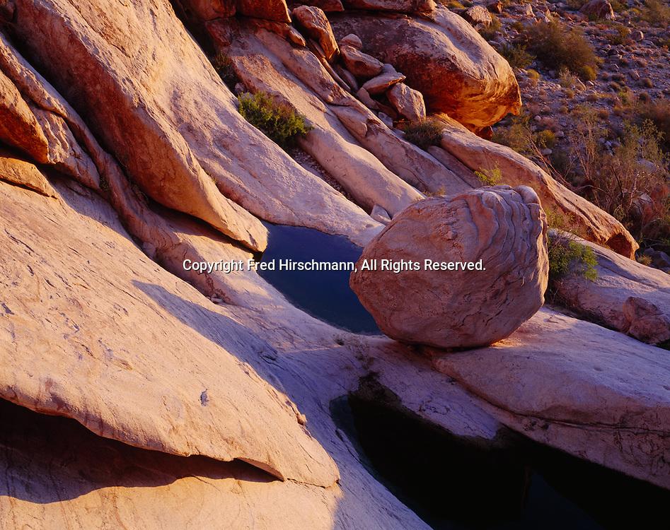 Sculpted boulder adjacent to Tinajas Atlas, an important water source in the Tinajas Atlas Mountains, Barry M. Goldwater Air Foce Range and Bureau of Land Management lands, Arizona.