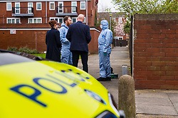Forensics investigators at the scene at Knights Close in Hackney where police were called to a domestic incident where a man was said to be making threats with a knife and was subsequently shot, sustaining life-threatening injuries, whilst one police officer suffered a knife wound. London, March 20 2019.