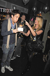 DUNCAN STIRLING and SABINE ROEMER at a party to celebrate the 1st birthday of nightclub Kitts, 7-12 Sloane Square, London on 5th March 2008.<br />