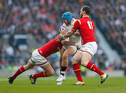 England Winger Jack Nowell is tackled by Wales Fly-Half Dan Biggar and Winger George North - Mandatory byline: Rogan Thomson/JMP - 12/03/2016 - RUGBY UNION - Twickenham Stadium - London, England - England v Wales - RBS 6 Nations 2016.