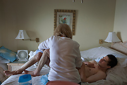 Judy Cox takes care of her son Chris, 29, a traumatic brain injury survivor, Destin, Fla., Nov. 19, 2011. Judy and her husband Wayne take care of their son, who was left with debilitating back pain after an A.T.V. accident. Cox underwent physical therapy to no avail and accidentally overdosed on Oxycontin, leaving him clinically deceased for 15 to 30 minutes. He was revived but suffered severe lack of oxygen to his brain and was diagnosed as minimally conscious. Cox's family entered him into a clinical trial, testing medicines that evoked Òparadoxical excitation,Ó such as Ambien, and have witnessed a heightened sense of awareness in their son.