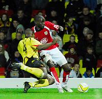 Photo: Leigh Quinnell/Sportsbeat Images.<br /> Watford v Bristol City. Coca Cola Championship. 01/12/2007. Bristol Citys Enoch Showunmi is challenged by Watfords Dan Shittu.