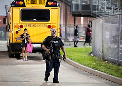 August 18, 2018 - Wellington, Florida, U.S. - Police respond to a shooting at Palm Beach Central High School. Two adults were shot Friday night at a football game between Palm Beach Central and William T. Dwyer high schools, authorities said. The gunfire sent players and fans screaming and stampeding in panic during the fourth quarter of the game at Palm Beach Central High School in Wellington, Florida on August 17, 2018. (Credit Image: © Allen Eyestone/The Palm Beach Post via ZUMA Wire)